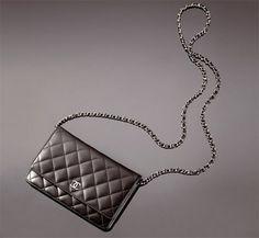 Black CHANEL lambskin wallet on a chain. So versatile, you can wear it so many ways (short, long, cross-body, clutch...)
