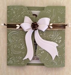 "One of the versions of my baby shower invitation for our baby boy using Anna Griffin products. This is the Ribbon Flower Gatefold 12"" folder and one of the bow dies."