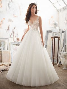 Read More on SMP: http://www.stylemepretty.com/2016/11/01/these-gowns-an-absolute-dream/