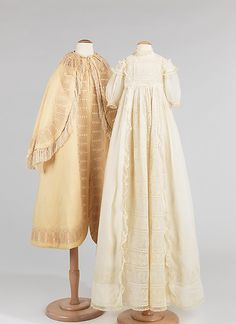 Infant's embroidered white cotton christening dress and beige wool coat with fringe trim, American, 1868.