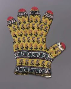 "Glove ""from the stores of the Nizam of Hyderabad."" Material: very fine wool. Design: alternate rows of small orange and blue flowers, on yellow ground, ends of fingers … Fair Isle Knitting, Hand Knitting, Knitting Designs, Knitting Patterns, Crochet Doilies, Knit Crochet, Textiles, Crossed Fingers, Antique Lace"
