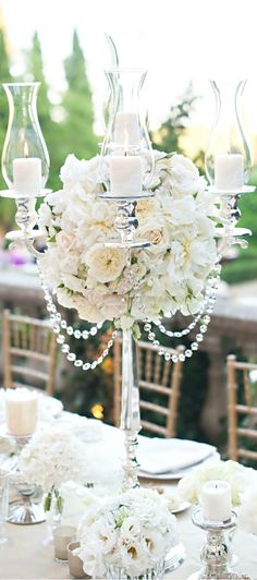 Roses, silver and crystal wedding centerpiece