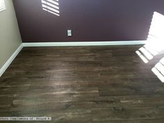 Mocha Oak laminate flooring in the bedroom paired with purple walls! Love this rustic flooring!  Photo compliments: Ronald R.