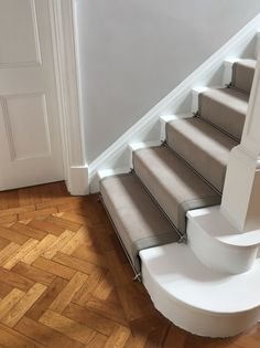 Taped Grey Carpet Stair Runner : Ulster Carpets Grey Velvet carpet fitted as taped stair runner with complimenting tape and Pewter stair rods to white painted staircase. Solid oak parquet herringbone wood flooring fitted in hallway Tiled Hallway, Hallway Flooring, Wood Flooring, White Staircase, Staircase Design, House Staircase, Staircase Diy, Staircase Remodel, Victorian Hallway