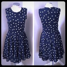 """Super Cute Navy Polka Dot Dress with a Girly Flare This dress is very cute, fun and flirty! I actually purchased it from another posher and loved it, however the length was a tiny bit shorter than I would have liked it to be (I'm 5' 8""""). There is a teeny tiny snag in the back (pic shown) but it isn't noticeable whatsoever (the close up just shows it much bigger than it is). There is someone out there who would definitely love and rock this dress!  It is really cute! The tag says XL (I would…"""