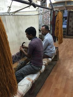 Hand-knotting rugs in Agra