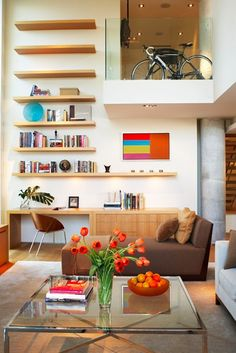 Open shelves can be the only decoration on a tall wall, c.a.p.