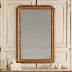 Eloquence® Louis Philippe Mirror in Etched Gold Eloquence® Louis Philippe Mirror in our etched Gold Leaf finish. Softly aged mirror glass. This Reproduction mirror is solid wood with applique beading.