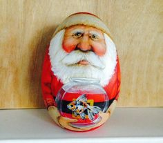 Santa Claus holding a calico goldfish. by WoodenEggArt on Etsy, $30.00