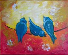 some cute little blue birds on a wire