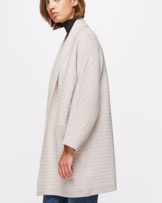 Woven from a super-fine merino wool yarn, this cardigan is soft to touch and is…