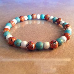 Tan and Blue-Green Magnesite Bracelet with Orange-Gold acrylic beads by CVioletJewelry