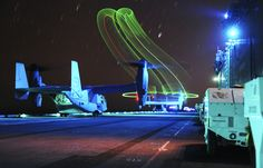 An MV-22 Osprey Fills The Night Sky Over The USS Boxer With Psychedelic Slinkies