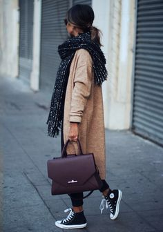 Julie Sarinana demonstrates the versatility of converse here, wearing them with a more sophisticated work look consisting of an oversized knit cardigan and a gorgeous Givenchy briefcase. Cardigan: Asos, Jeans: Asos, Shoes: Converse, Scarf: Zara, Bag: Givenchy.