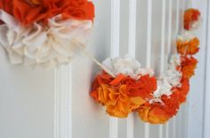 Halloween decorating gets cute with bright pom-pom garlands. The Etsy version uses fabric, but you can easily use tissue paper for a similar (and cheaper) effect.  Source: Etsy seller ThreadingMarigolds