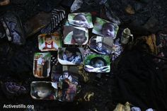 Photographs of Ali Saad Daobasa, the Palestinian baby in an overnight arson attack, are laid out on the floor of his family home, Douma, West Bank, July 31, 2015. (photo: Oren Ziv/Activestills.org)