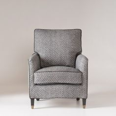 The tweed and shape of this chair are more masculin.  Then we could add pretty flowers or some shiny/bright patterned pillows to add some softness.