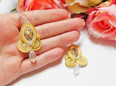 Yellow soutache earrings, Silver earrings, Crystal clear Earrings, Elegant earrings, Fashion Modern Earrings, Gift for women for Christmas This beautiful earrings are made in soutache embroidery technique. The color is combination of yellow, Crystal clear and silver. They are made with Rayon Soutache, Glass Beads, Acrylic BeadsSeed Beads and Suede on the back. The earrings findings are hypoallergenic. Size: length 6 cm (3 inches) width 2.5 cm (1,1 inches) They are light and comfortable. Al... Soutache Earrings, Silver Earrings, Drop Earrings, Jewelry Design, Unique Jewelry, Embroidery Techniques, Beautiful Earrings, Gifts For Women, Glass Beads