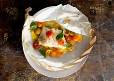 fish fillets in parchment w/ tomatoes,  squash, and basil