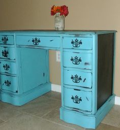 Antique desk painted turquoise with chalkboard top and side panels