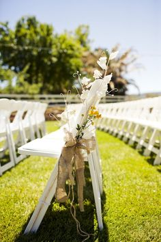 Burlap bows as wedding decor / pew decoration.