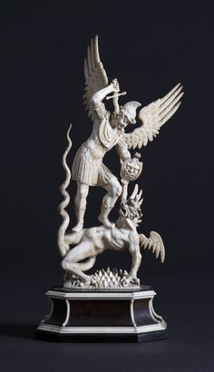 Carved Ivory Figure of St. George & the Dragon.