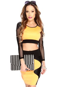 ets are definitely in as seen on our fave fashion icons! This two piece set features cropped top mesh sleeves, netted faux leather shoulders, followed by a matching pencil skirt. Pair this set with your favorite single soles for the perfect look. 65% Polyester 32% Rayon 3% Spandex Made in USA.