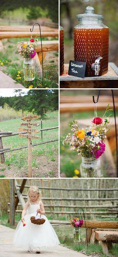 Love the mason jar flowers on shepherd hooks... #wedding #flowers