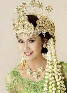 Beautiful Indonesian Woman in traditional costume,  Indonesia.  a contemporary Sumatran bride who wears this traditional style of headdress.