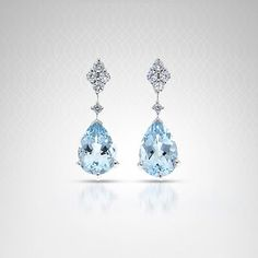 Diamond and Aquamarine Drop Earrings in White Gold - Elegant drop earrings feature pale blue 9 X 6 pear shaped aquamarines set in white gold with diamond accents. Aquamarine Earrings, Solitaire Earrings, Diamond Drop Earrings, Diamond Studs, Dangle Earrings, Turquoise Jewelry, Gemstone Jewelry, Marquise Diamond, Blue Chalcedony