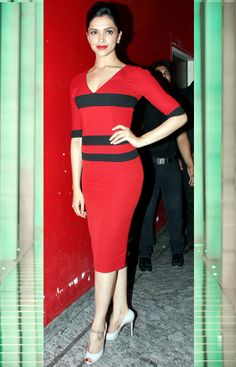 Deepika Padukone looks sizzling in this red number with black stripes. #Bollywood #Fashion