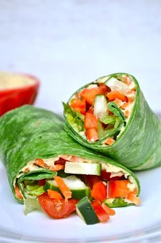 Vegetable Hummus Wrap with Spinach, Hummus, Cucumber, Red Pepper, Shredded Carrots, Tomato, Lettuce.