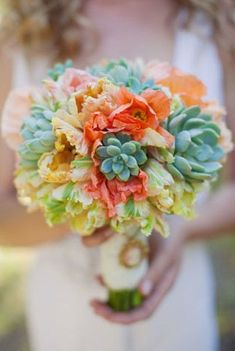 Orange tulips and green succulents bouquet.  Click to see more inspirational images: http://blog.mangomuseevents.com/page/5/