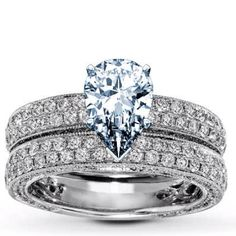 Pear engagement ring with two bands of diamonds on band and side diamonds <3