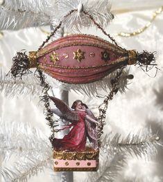 Angel and Child Riding in Glass Zeppelin ornament handmade by Lara's Lovelies Victorian Christmas, Primitive Christmas, Rustic Christmas, Handmade Christmas, Antique Christmas Decorations, Vintage Christmas Ornaments, Christmas Crafts, Vintage Decorations, Christmas Houses