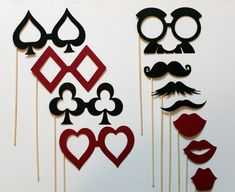 Next, make a fun casino themed masks and mount them on wooden skewers using red, black and white paper for your guests to pose with for pictures and play with during the party.