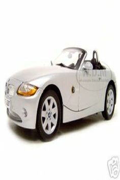 Brand new 1:18 scale diecast model of BMW Z4 die cast model car by Motormax . Has steerable wheels. Brand new box. Rubber tires. Made of diecast with some plastic parts. Detailed interior, exterior, engine compartment. Dimensions approximately L-10, W-4, H-3 inches. BMW Z4 Convertible Diecast Model Silver 1/18 Die Cast Car by Motormax Bmw Models, Bmw Z4, Rubber Tires, Diecast Model Cars, Convertible, Scale, Wheels, Box, Vehicles