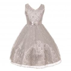 An amazing junior bridesmaid special occasion dress from Shanil Inc. With a girly polished style, great embellishment and cut in elaborate material, this junior bridesmaid dress will complete a chic and stylish attire. The silver sleeveless dress has a br