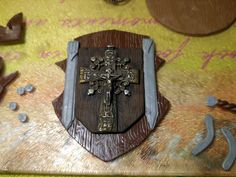 This shield is influenced by the Templars. The cross was something i picked up in Poland, in 2005. swords are almost done. Polymer Clay Art, Swords, Poland, Sword, Ignition Coil