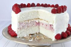 This unique combination of fluffy cake and frozen cheesecake creates a large stunning raspberry layer cake. Created by popular food blogger