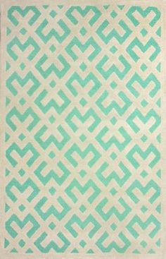 A mint rug is a great way to add mint to your mint and gray nursery! Place it in front of a gray crib for contrast!