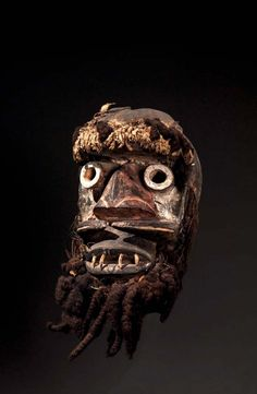 Africa | Mask from the Guere people of the Ivory Coast | Wood, pigment, hair, plant fiber and textiles