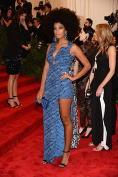 """Fashion diva Solange Knowles never gets it wrong.  And at the MET Gala was no different.  The """"Losing You"""" singer stepped outside the box and rocked a printed blue Kenzo dress for, as she called it, an """"Afro Punk"""" look.  And we're loving every bit of it.  The hair, that slit, and those gorgeous earrings.  Love it!"""