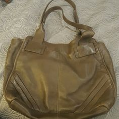"Perlina grey leather shoulder bag Used ""vintage look"" leather hobo shoulder bag. Fits a lot of stuff. Shows signs of wear, has a loose thread on bottom stitch. Approx. 14x11 Perlina Bags Hobos"