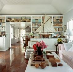 light and airy lounge - love the idea of the books covers in manila/kraft paper! clever and pretty