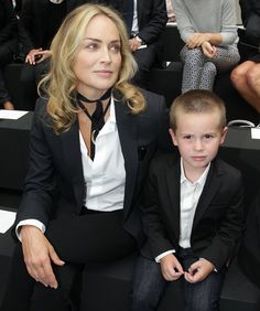 It's Sharon Stone!  -- Dressed just like each other, Quinn and mom Sharon Stone (star of Basic Instinct) attend a fashion show in Paris. Quinn is little brother to Laird and Roan.