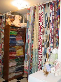 More stash storage and hanging quilts in the room next to Judy Martin's sewing room.