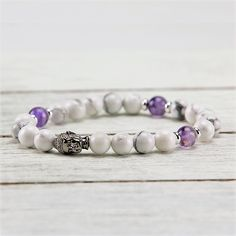 Featured Stones: Howlite, Amethyst, Silver Use it as an aid for insomnia, let it be the patron of your heart, and quicken your intelligence. Buddha Beads, Amethyst Bracelet, Beaded Bracelets, Stud Earrings, Gemstones, Silver, Jewelry, Collection, Products