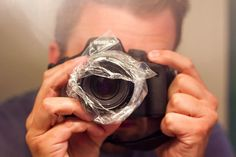 How to Get the Dreamy Effect - from Photography Is The Biggest Lie Ever, via thinkinghumanity;  The plastic bag around the lens gives the photo a cloudy look, sort of like a bokeh effect without the spots.