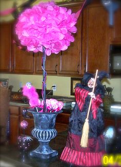 Pinkoween centerpiece used for a pink Halloween birthday party.